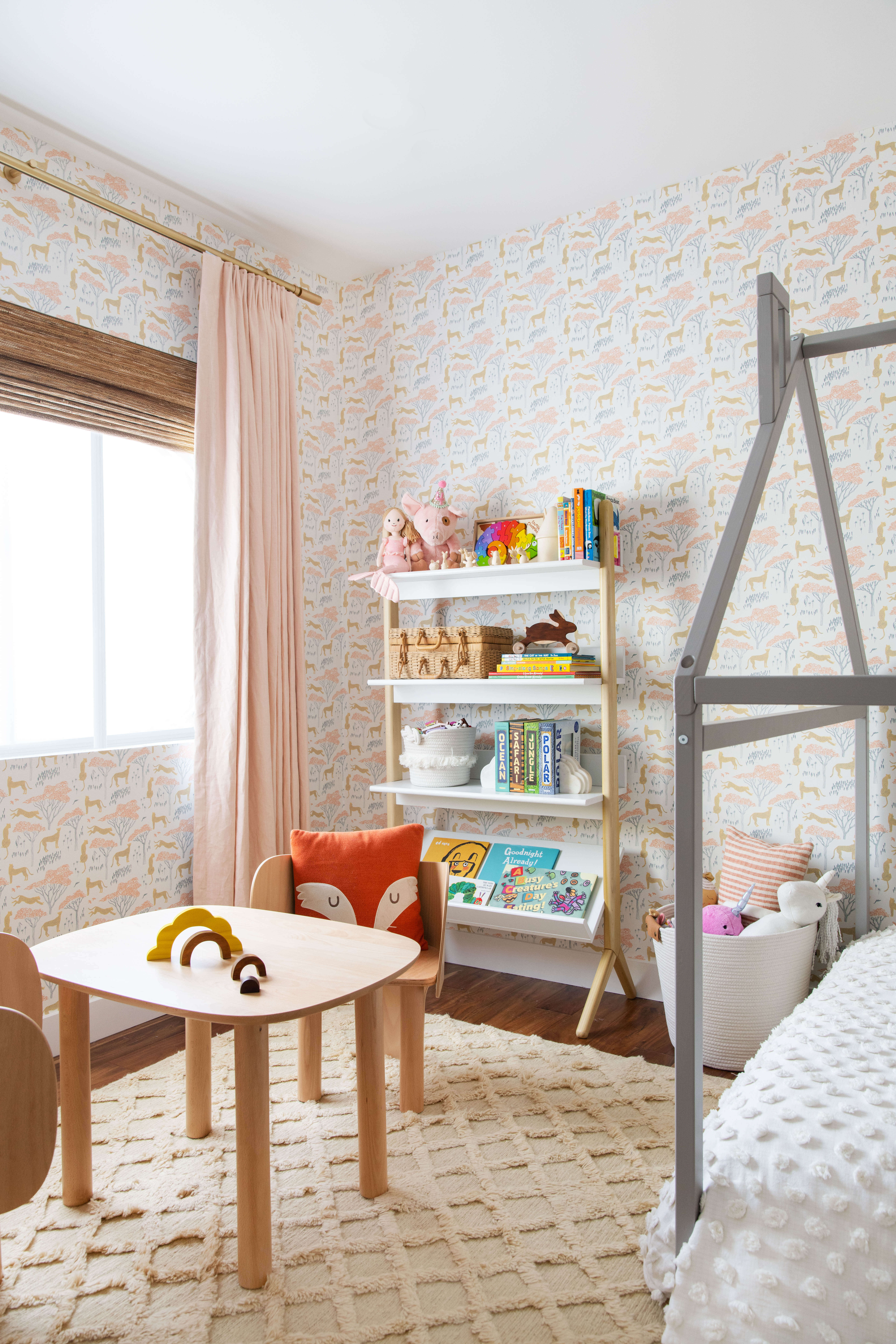 Ginny Macdonald Design girl's bedroom light wood play table and bookcase