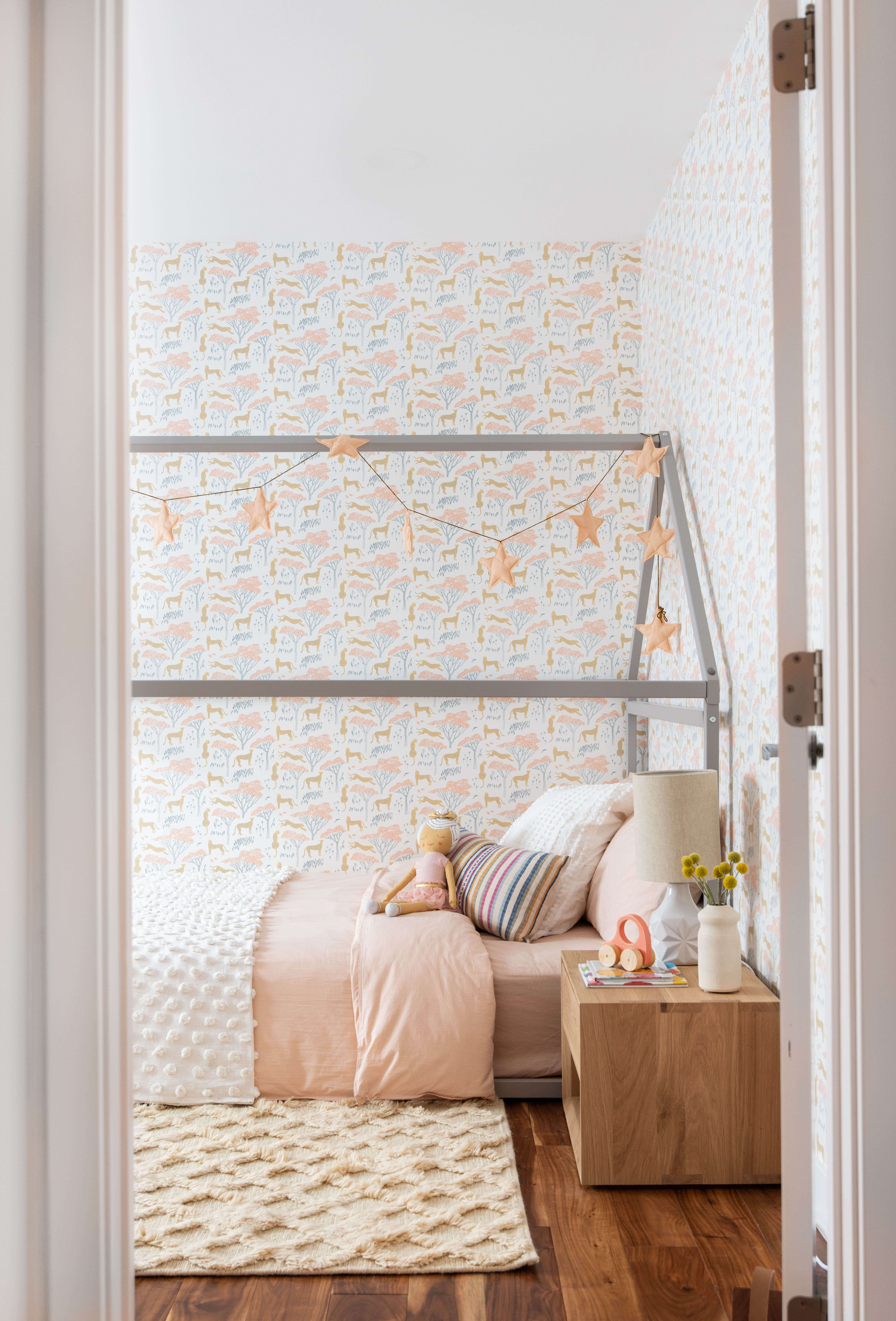 Ginny Macdonald Design girl's bedroom with safari wallpaper and Armadillo Co rug