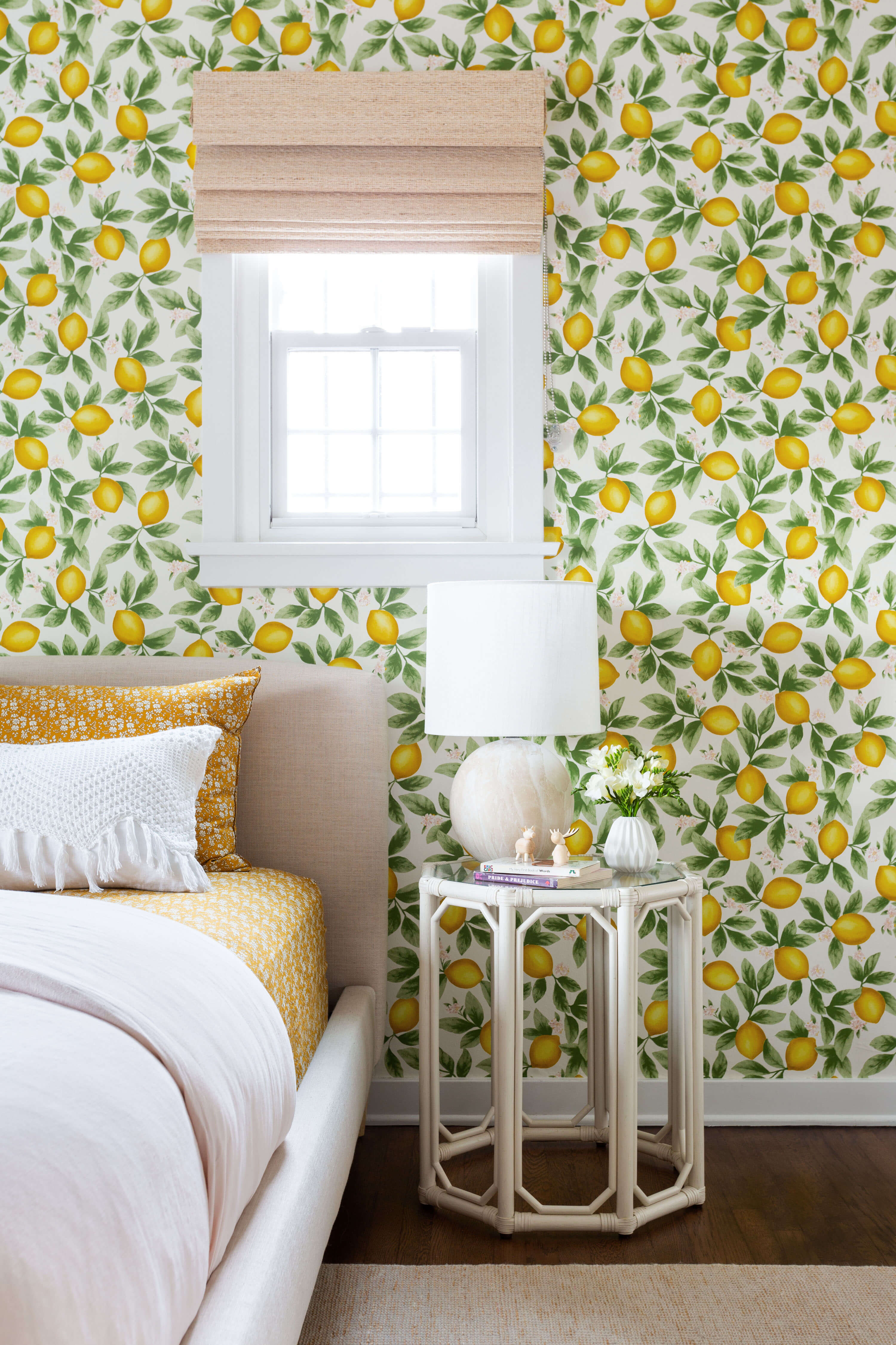 Ginny Macdonald and Lulu & Georgia girl's bedroom with white side table and floral mustard bedding