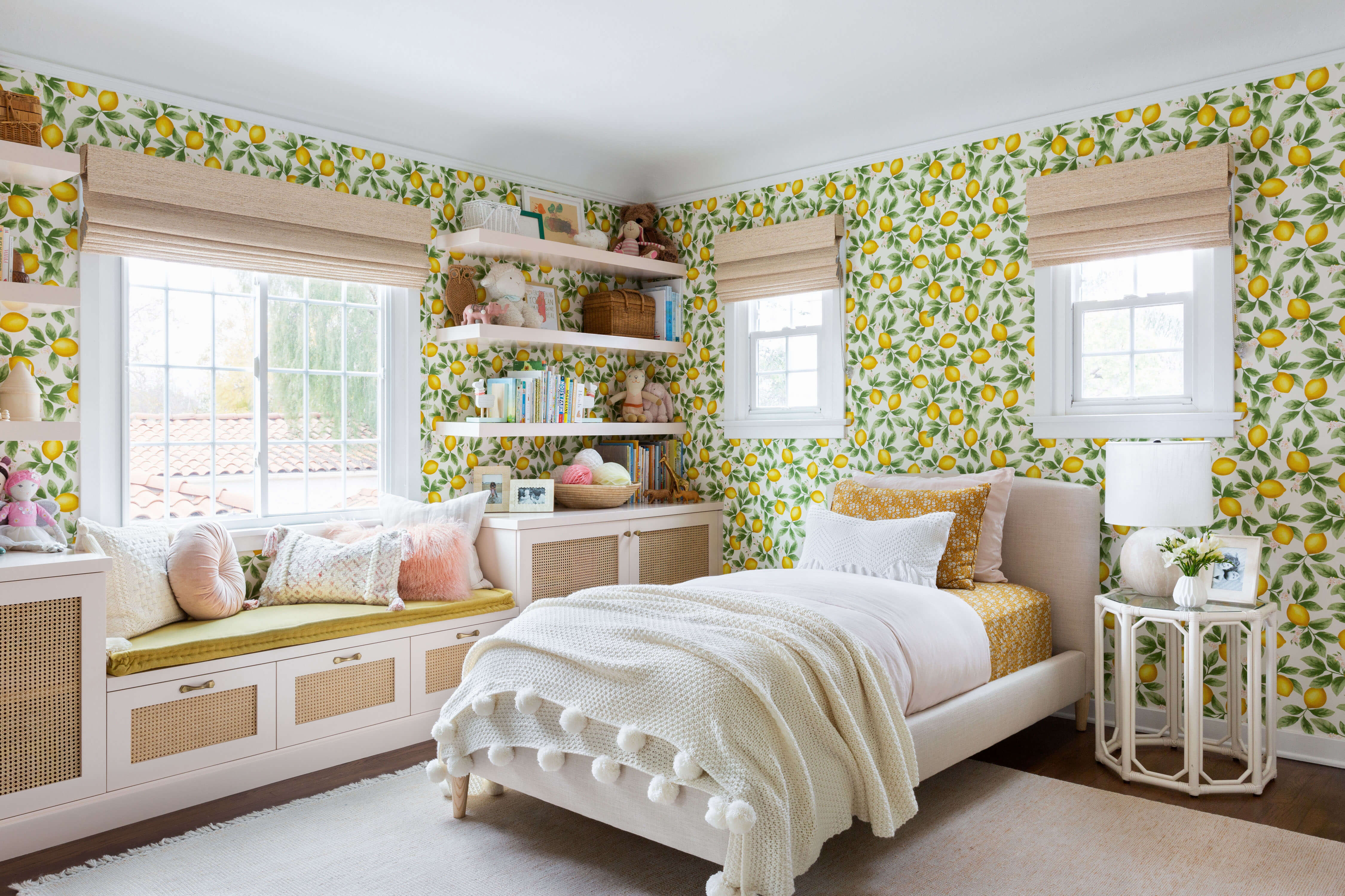 Ginny Macdonald and Lulu & Georgia girl's bedroom with lemon wallpaper and pink built in bookcase