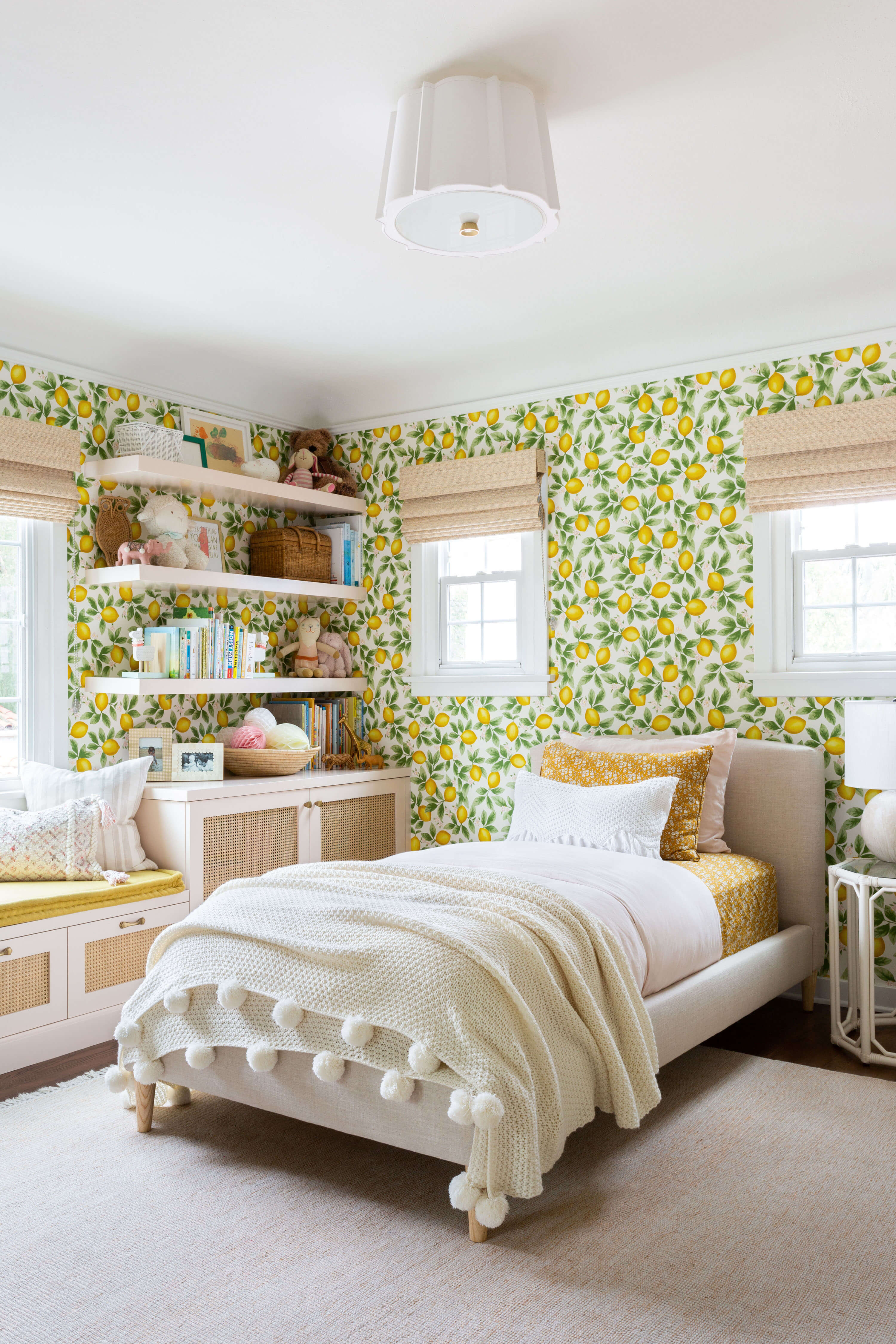 Ginny Macdonald and Lulu & Georgia girl's bedroom with lemon wallpaper and pink built in cabinet