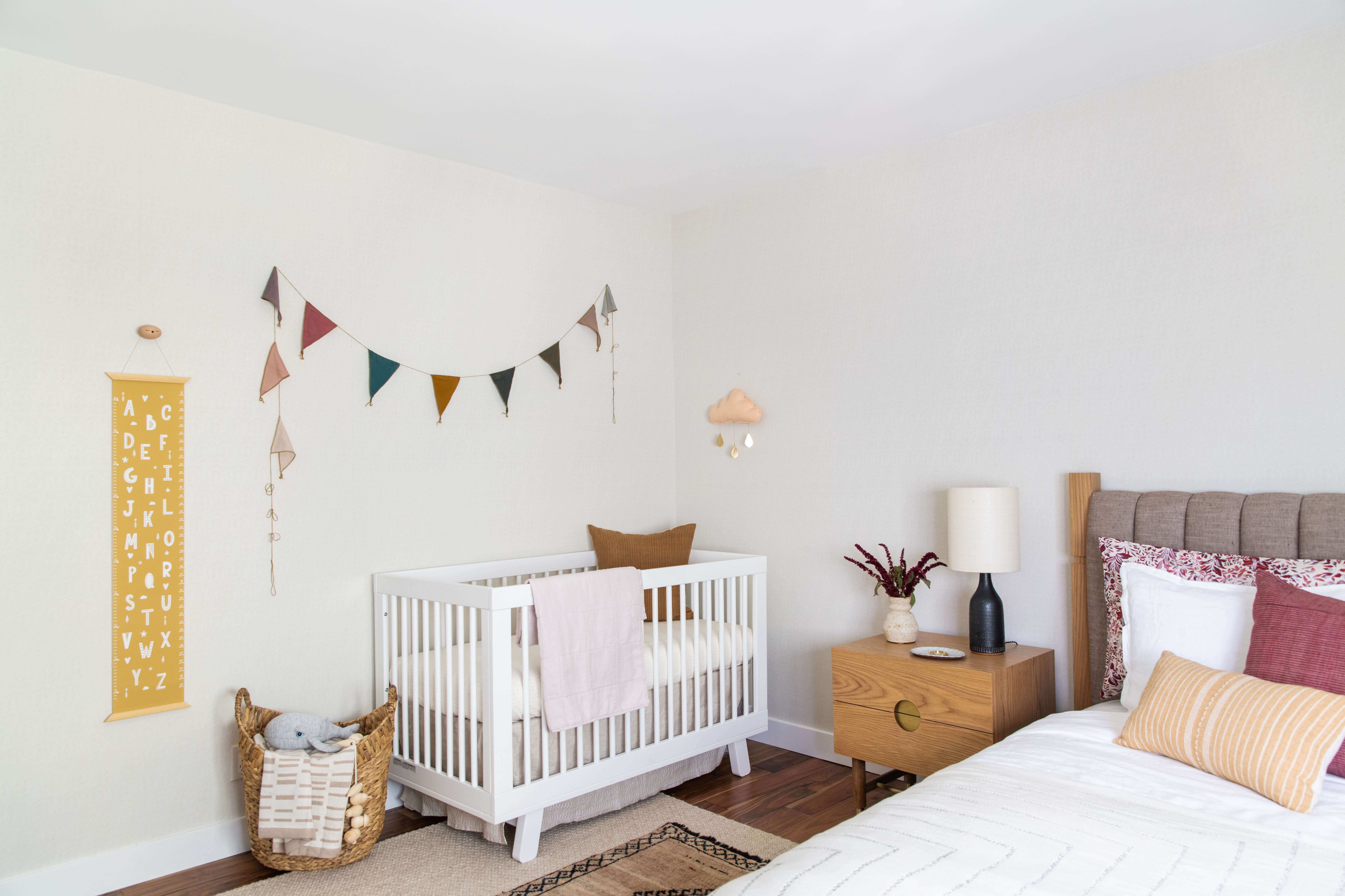 Ginny Macdonald Design nursery with multi coloured bunting