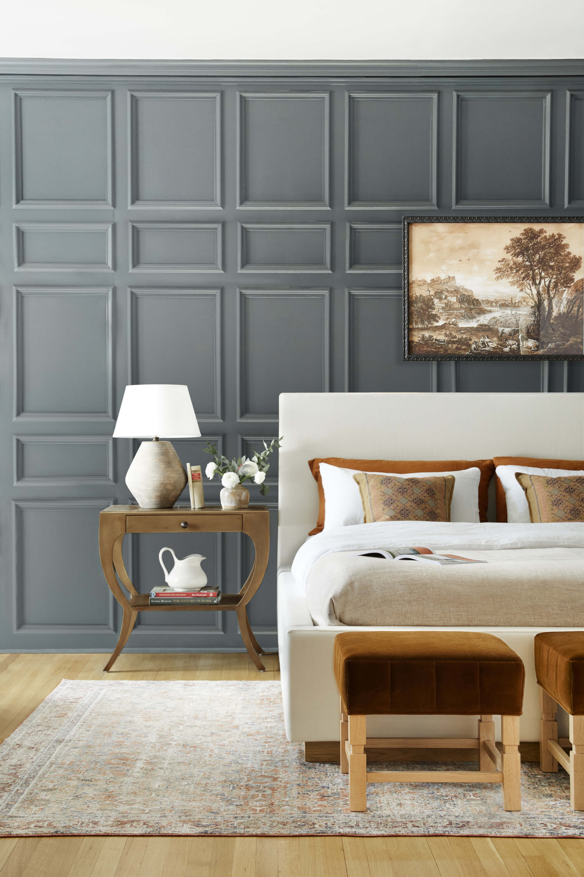 Dark blue panelled wall panelled living room. Design by Ginny Macdonald Design