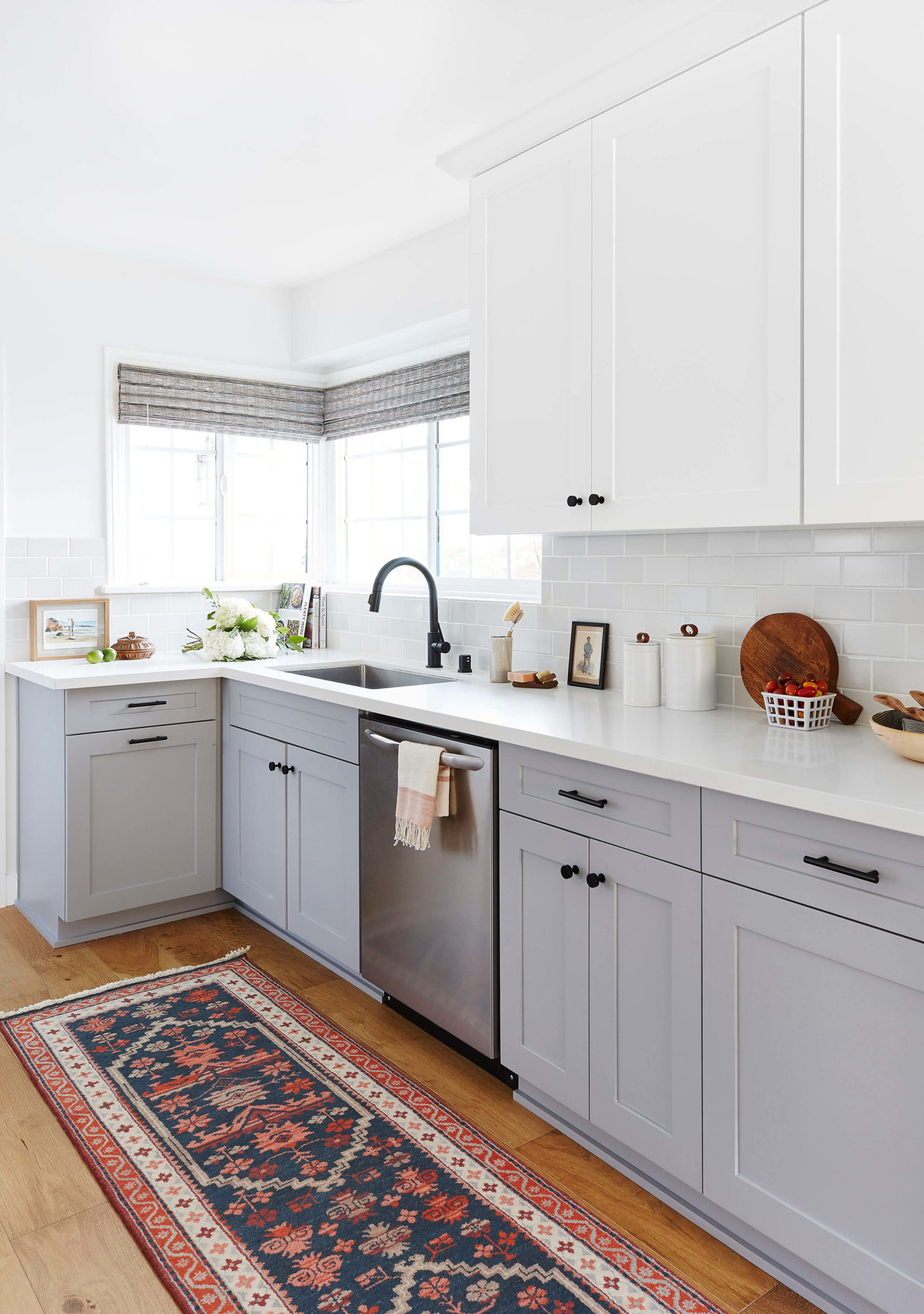 Grey shaker kitchen with tradtional rug interior design by Ginny Macdonald Design