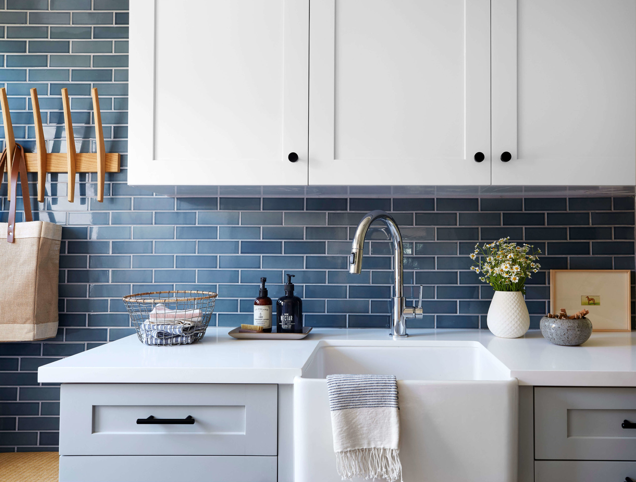 Laundry room blue tile backsplash interior design by Ginny Macdonald Design
