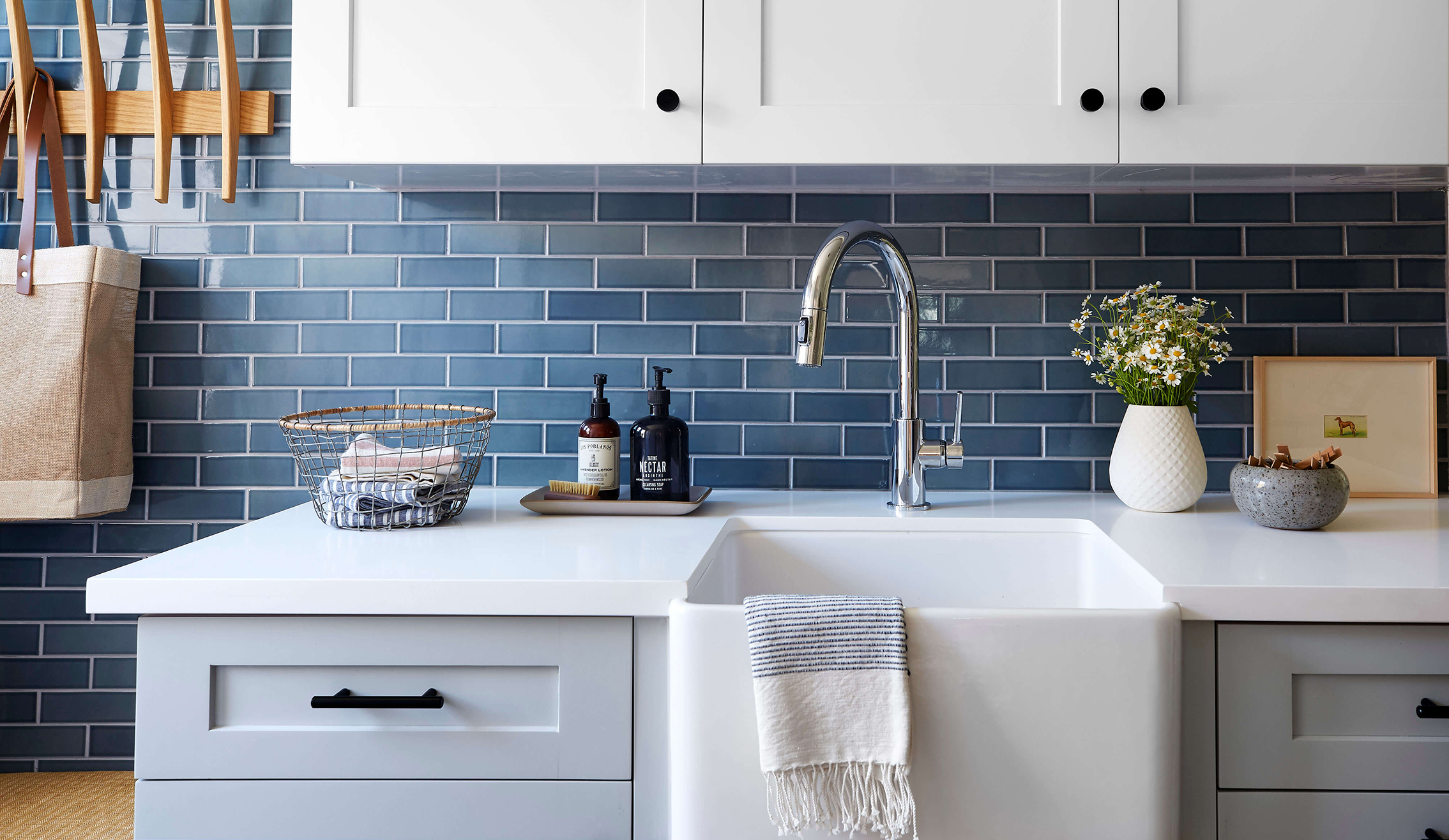 Laundry room ocean blue tile backsplash interior design by Ginny Macdonald Design