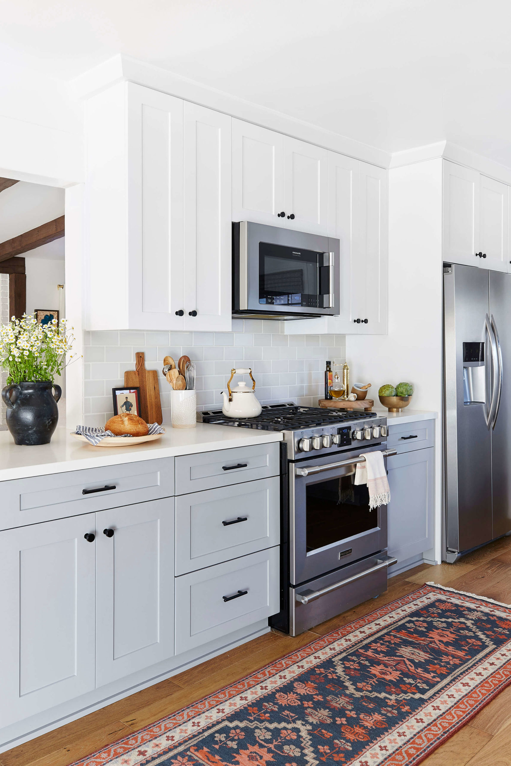 Stainless steel appliances in shaker kitchen interior design by Ginny Macdonald Design
