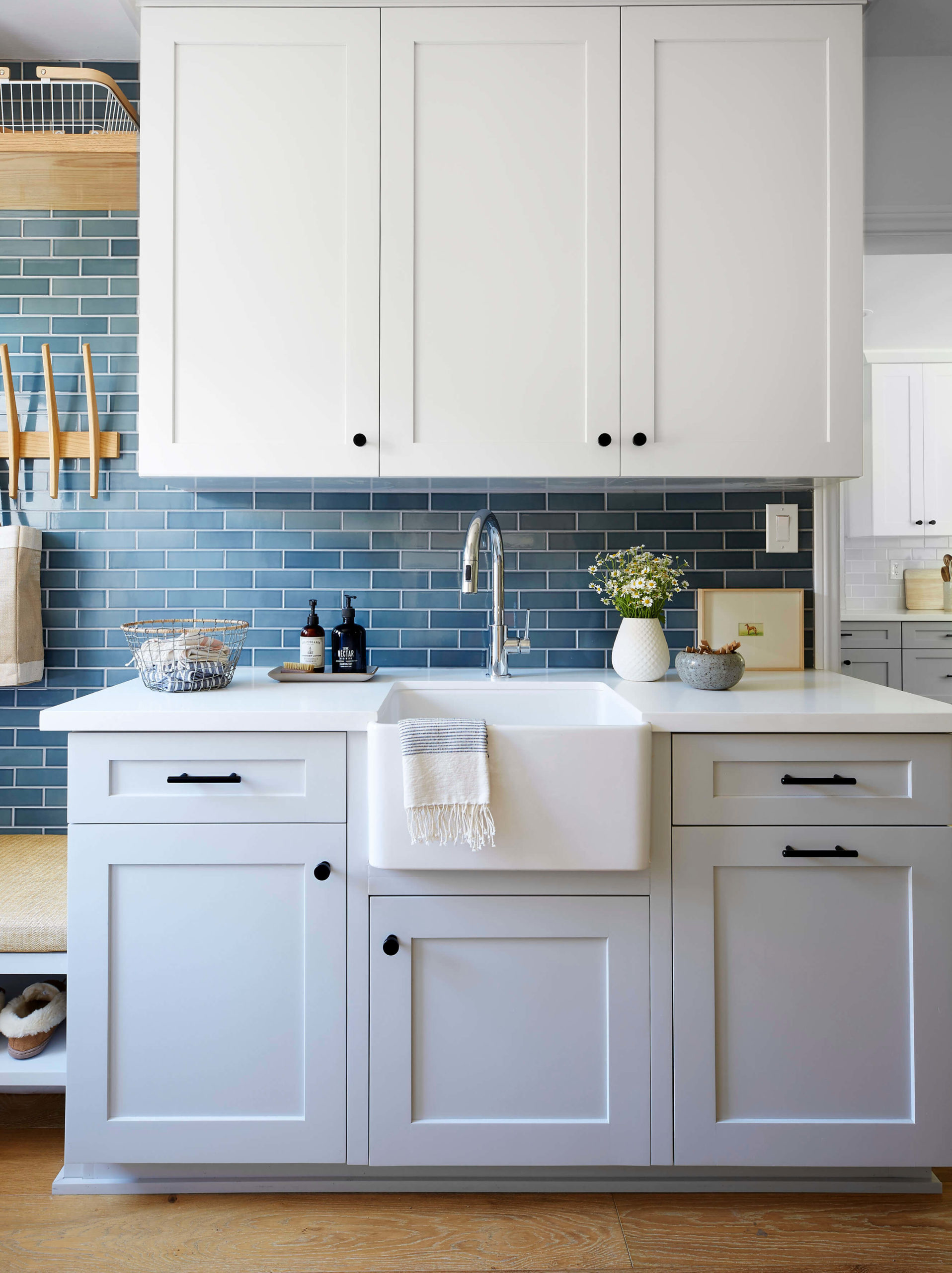 White and grey laundry cabinets interior design by Ginny Macdonald Design